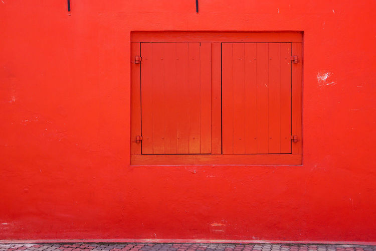 Close-up of closed door of red wall