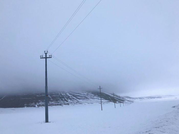 Fog Snow Cold Temperature Winter Sky Cable Scenics - Nature Beauty In Nature Environment Frozen Connection Electricity  Landscape 17.62°