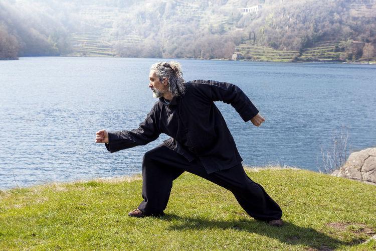 Man exercising by lake