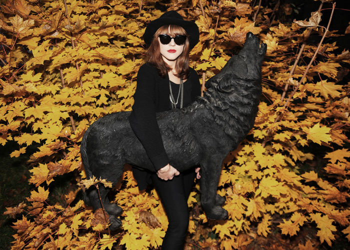Portrait of woman with autumn leaves outdoors