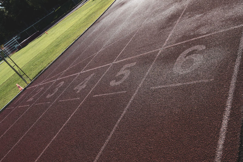 tartan running track starting line Tartan Track Athletics Sport Running Stadium Competition Speed Lanes Track And Field Running Track Number Sports Track No People Outdoors Grass Playing Field Sports Race Competitive Sport Absence Day Beginnings Single Line Starting Line Dividing Line High Angle View Nature