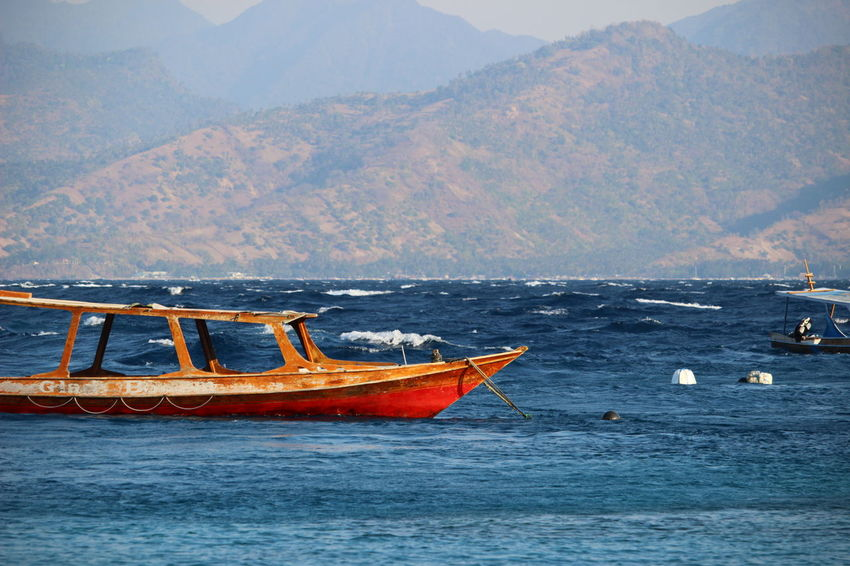Beauty In Nature Boat Day Mode Of Transport Moored Mountain Nature Nautical Vessel No People Outdoors Scenics Sea Sky Transportation Water Waterfront