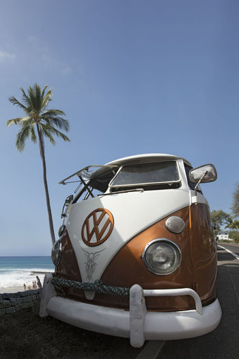 VW Microbus at the beachside with Palm tree Beach Life California Coast Palm Tree VW Beach Car Clear Sky Day Hawaiian Islands Horizon Over Water Iconic Car Land Land Vehicle Mode Of Transportation Motor Vehicle Nature No People Outdoors Palm Tree Plant Sea Sky Surfing Transportation Tree Tropical Climate Vintage Car Water