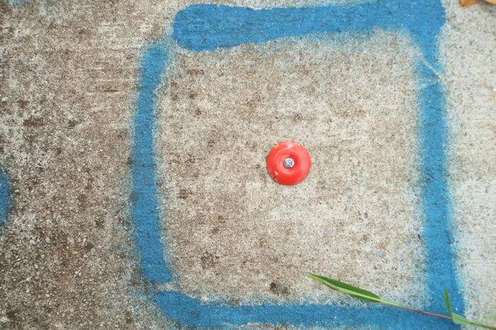 Blue Red Symbol Outdoors Concrete Day No People Creativity Circle