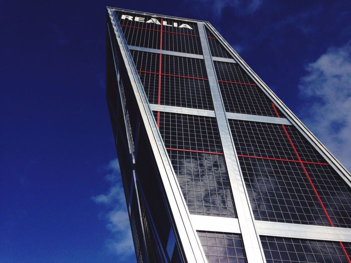 Madrid Spain Low Angle View Sky Built Structure Environmental Conservation Architecture No People Day Outdoors Building Exterior City Alternative Energy Solar Panel Renewable Energy Nature Skyscraper Office Block