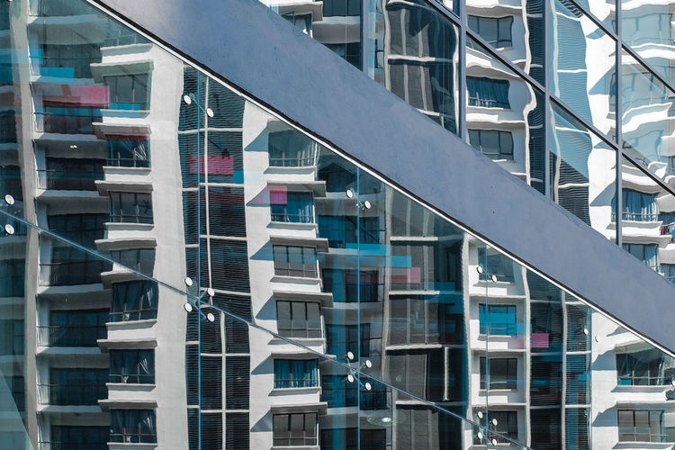 Glass reflection of modern building in city