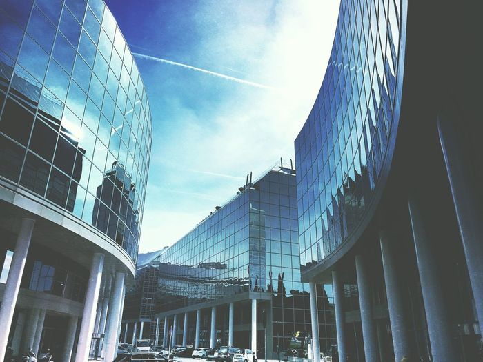 Office Building Office Building Exterior Built Structure Sky Architecture Building Exterior Low Angle View Nature Day No People Cloud - Sky Building City Decoration Outdoors Sunlight Glass - Material Travel Destinations Blue