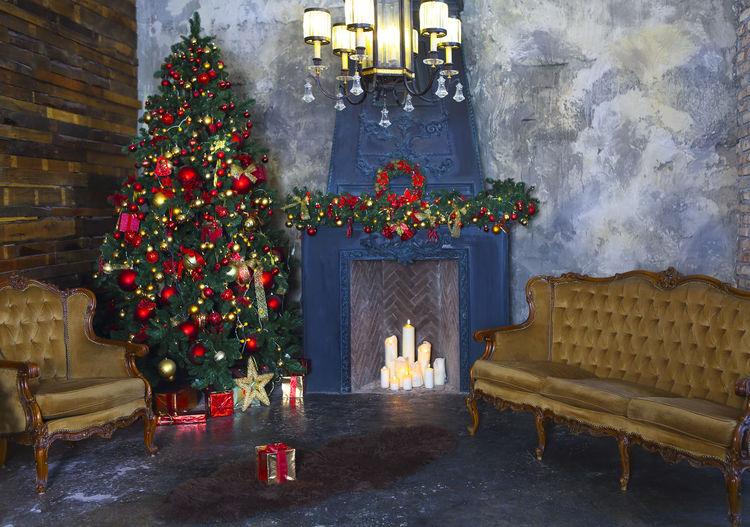 Illuminated christmas tree against building