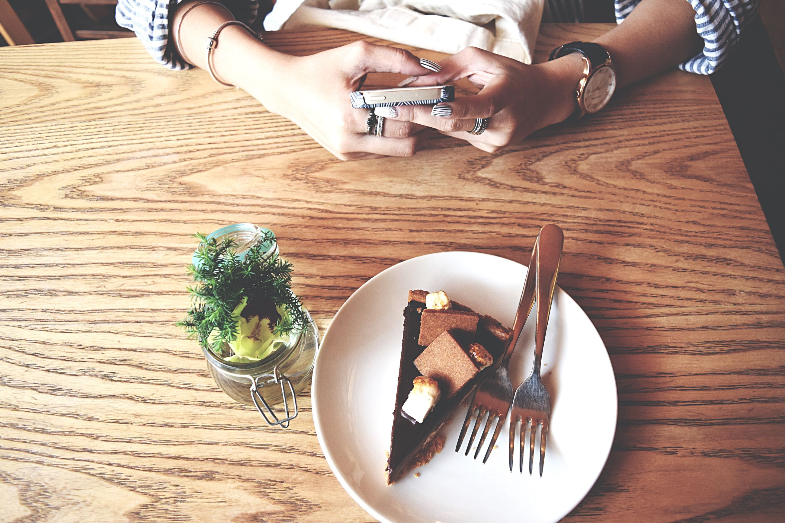 person, indoors, table, food and drink, food, plate, high angle view, part of, freshness, lifestyles, holding, leisure activity, cropped, wood - material, healthy eating, unrecognizable person