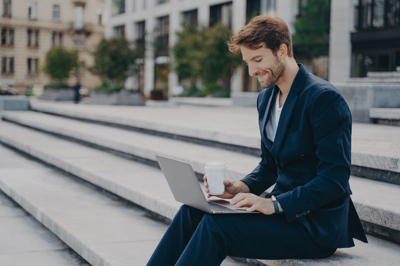 Man using mobile phone while sitting in office