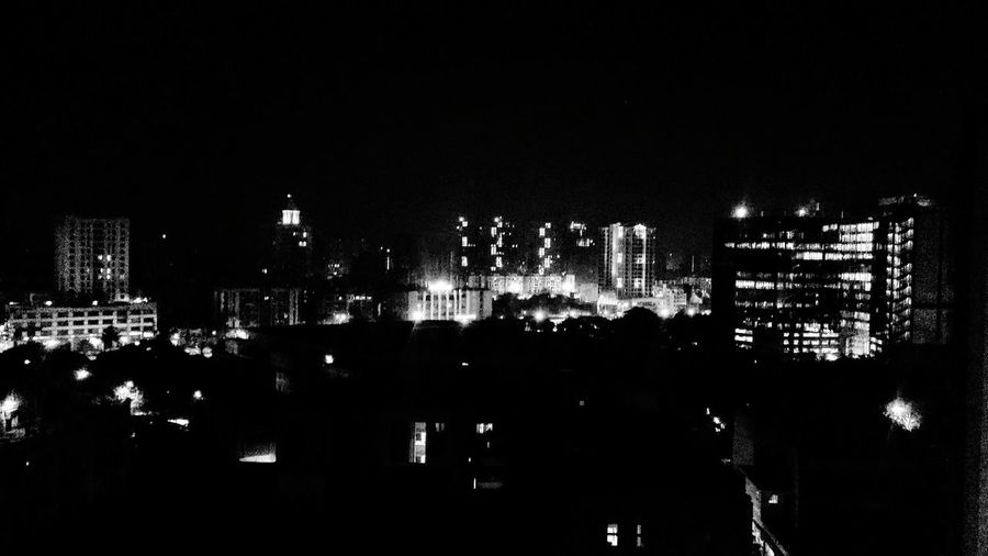 Monochrome Photography Illuminated Cityscape No People Night Architecture Outdoors Shotfromthebalcony Midnightphotography Blackandwhite Urban Architecture City Life