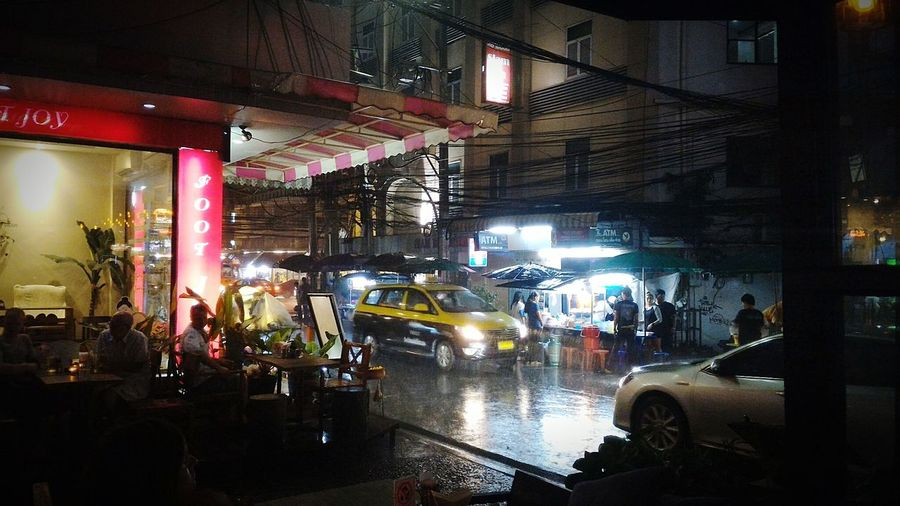 Illuminated Night Lighting Equipment Nightlife People Night Photography Streetphotography City Life Thailand Bangkok Raining Outside Rainy Season Taxı Cab Outdoors