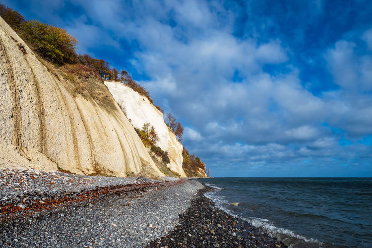 Baltic Sea coast on the island Moen in Denmark. Sea Water Beauty In Nature Scenics - Nature No People Nature Outdoors Cloud - Sky Landscape Sky And Clouds Coast Shore Baltic Sea Chalk Cliffs White Cliffs  Moen Moensklint Denmark Scandinavia Stones Rocks Travel Destinations Tourism Vacation Relaxing
