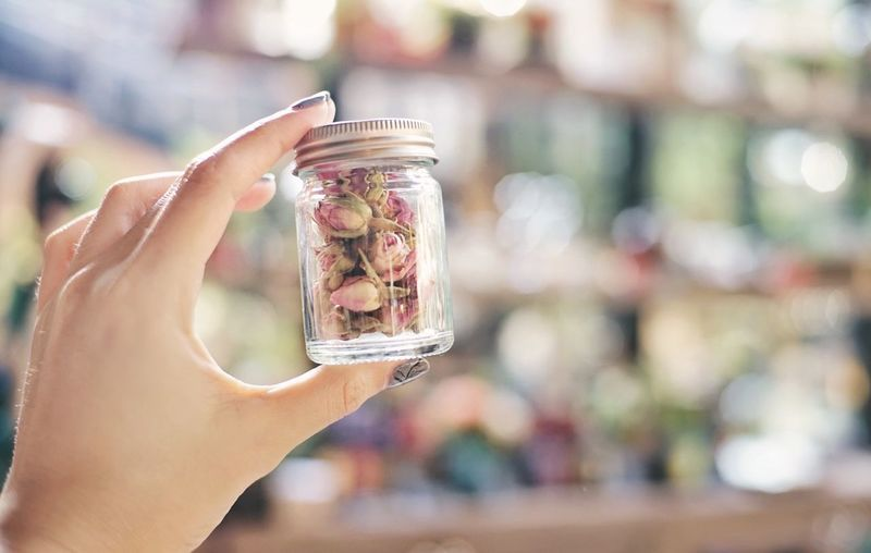 Close-up of woman holding glass jar