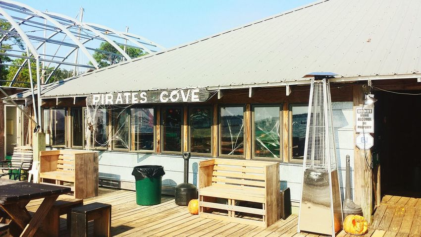 Drinks Meeting Friends Relaxing Beautiful Fall Day The Places I've Been Today Pirates Cove know its getting cold when you see the space heater at your favorite boat hangout! Summer Is Over Bars Hangout No People Taking Photos Hanging Out Sunny Day