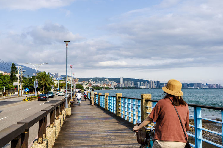 taking a bicycle renting trip at Taiwan Tamsui fisherman's wharf with stunning b beauty scenery Opening Sky  Travelers Bicycle Lane Sky Bike Along The Pier Lifestyles Travel Therapy Architecture Leisure Activity Summer Trip Cycling Perspective View Bike Lanes The Traveler - 2019 EyeEm Awards