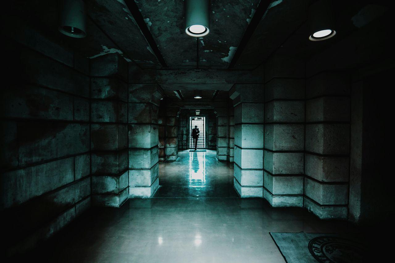 Illuminated corridor in building