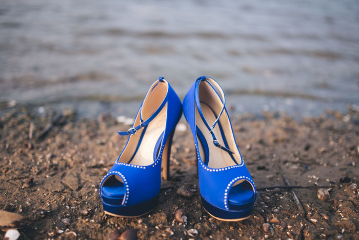 Blue Wedding shoes at the shore Absence Beach Beautiful Beauty Blue Blueshoes Close-up Day Fine Art Photography Focus On Foreground Gorgeous Lake Nature No People Objects Outdoors Product Photography Products Sand Sea Shoe Shoes Of The Day Shoes ♥ Shore Weddingshoes
