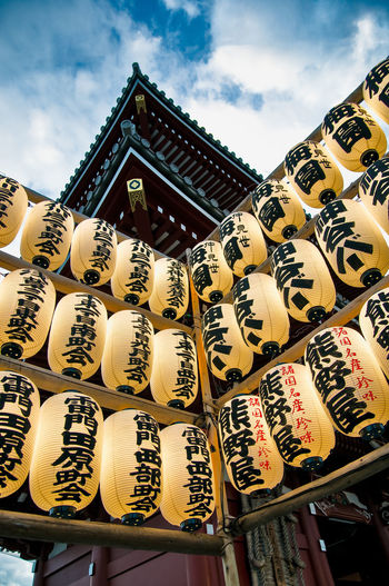 Low angle view of japanese lanterns hanging in asakusa kannon temple
