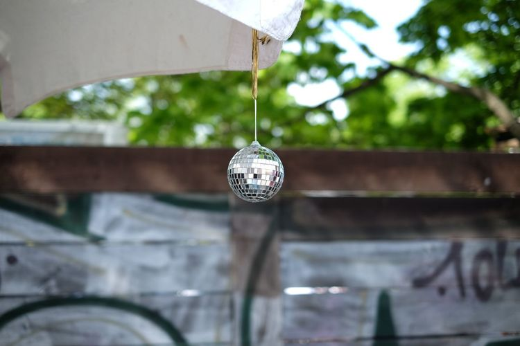 Architecture Building Exterior Built Structure Circle Close-up Day Decoration Discoball Fleamarket Focus On Foreground Hanging Low Angle View Metal No People Old Outdoors Part Of Railing Reflection Selective Focus Sunlight Tree
