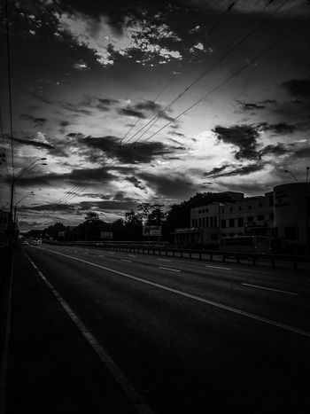 The Street Photographer - 2017 EyeEm Awards Road Built Structure Transportation Architecture Streetphotography Outdoors Sunset Street Street Photography Streetphoto_bw Sky
