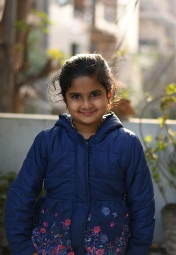 Portrait of smiling girl in winter jacket