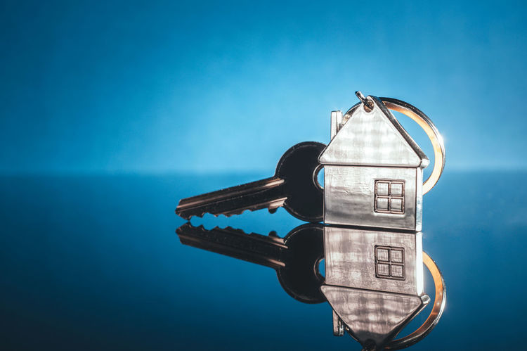 Key and house shape key chain on blue background. 1st House Future Plan Home Loan  RENT Blue Business Finance And Industry Close-up Finance Financial Future House House Keys House Loan Houses And Windows Investment Key Key Chain No People Real Estate