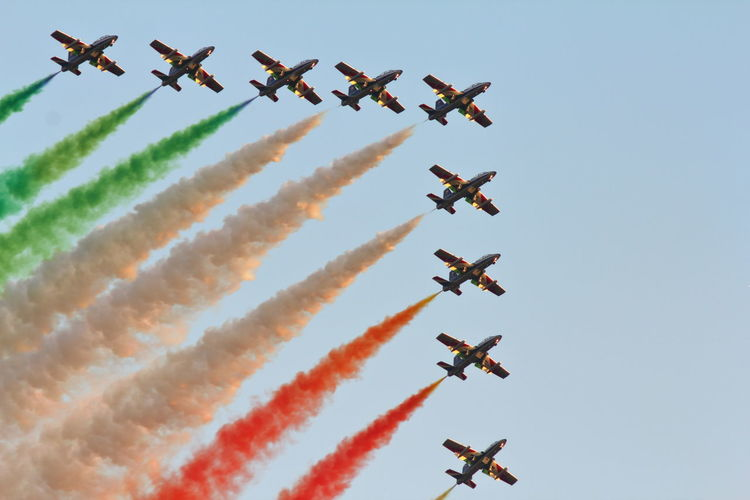 Frecce Tricolori Aerobatics Air Force Air Vehicle Airplane Airshow Arrangement Day Fighter Plane Flying Formation Flying Frecce Tricolori Low Angle View Military Airplane Mode Of Transport Motion Multi Colored No People Outdoors Performance Smoke - Physical Structure Speed Stunt Teamwork