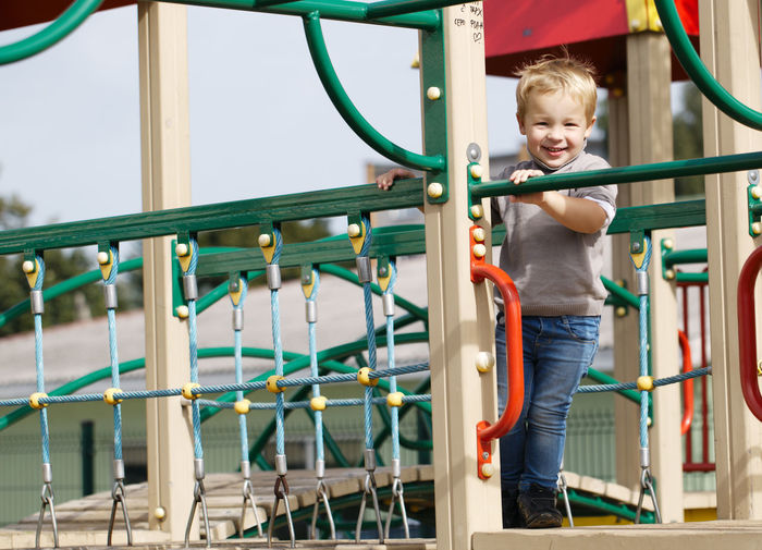 Portrait of cute boy standing at playground