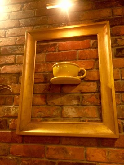 Indulgence Brick Wall Indoors  Low Angle View Illuminated No People Yellow Decoration Food Shape Close-up Laphotographiebleue Traveling Home For The Holidays Finding New Frontiers Coffee Coffee Time Coffee Cup Yellow Color YellowCup Funytime Funny Moments The Week On EyeEm Coffee Break Connected By Travel EyeEm Gallery