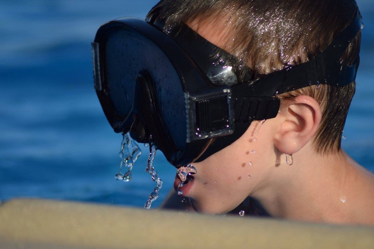 Close-Up Of Boy Wearing Swimming Goggles In Pool