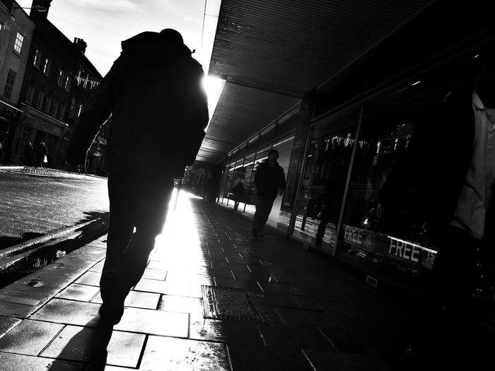 Walk into the light Blackandwhite Shootermag Streetphotography