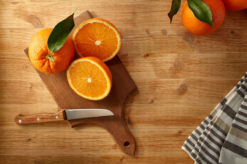Preparing an healthy orange juice for breakfast. Oranges on a cutting board. Food Therapy From Above  Vitamins Citrus Fruit Colored Fruit Cut Fruits Cutting Board Day Food And Drink Freshness Green Leaves Half Orange Healthy Breakfast Healthy Eating High Angle View Juicy Fruit Kitchen Knife Kitchen Stories Kitchen Table Orange - Fruit Orange Juice  SLICE Table Tasty Fruits Wood - Material