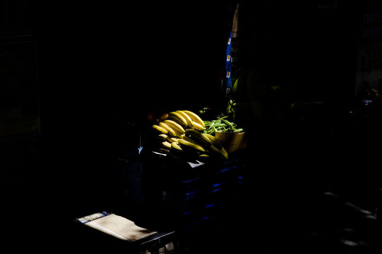 Bananas on sale outside a shop in Lavapies. Silhouette Bananas For Sale Black Black Background Close-up Food Freshness Fruit No People On Sale Yellow