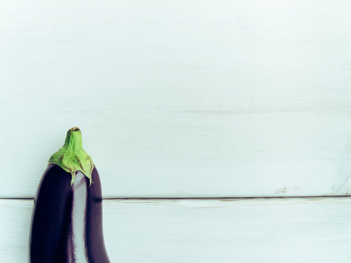 Directly Above Shot Of Eggplant On White Table