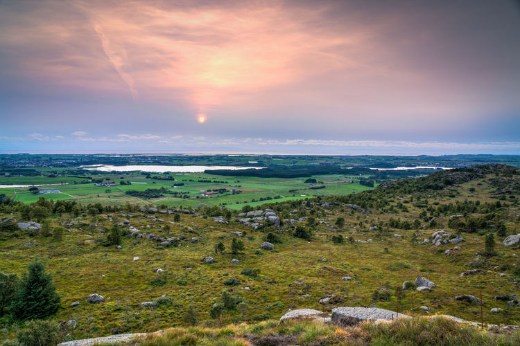 View over Bryne, Frøylandsvannet and Kvernaland, from Lyefjell Bryne Farm Frøylandsvannet Kvernaland Beauty In Nature Cloud - Sky Environment Field Grass Green Color Horizon Landscape No People Ocean Outdoors Scenics - Nature Sky Sun