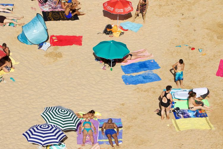 High Angle View Of People Enjoying Summer At Beach