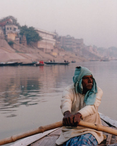 Boatman Ganges River India Indian Rowing Rowing Boat Tranquility Varanasi, India Ganges, Indian Lifestyle And Culture, Bathing In The Ganges, Varanassi Boat Boatman Indian Man Lifestyles Nature Nautical Vessel Oarsman One Person People Real People River River Ganges Scenics Sky Tranquil Scene Varanasi Water