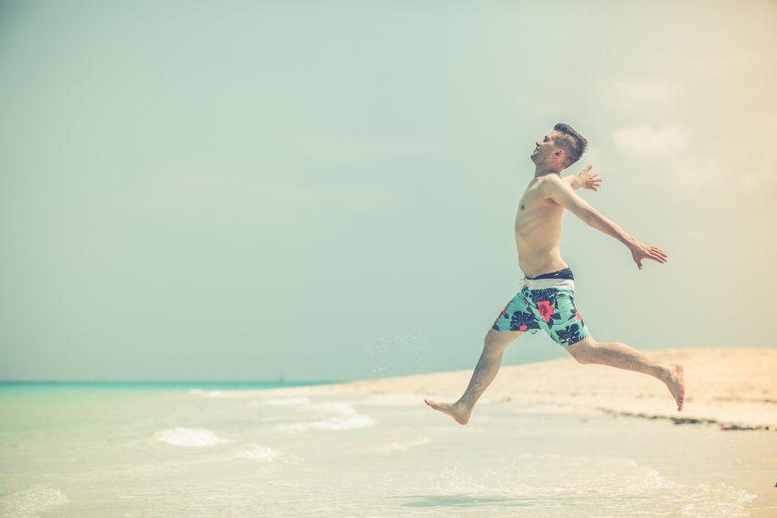 Africa Bathing Beach Boy Fun Guy Horizon Over Water Indian Ocean Island Leisure Activity Lifestyles Nature Ocean Posing Private Island Sand Sea Shore Sunshine Swim Vacations Water Young Adult Young Man Zanzibar