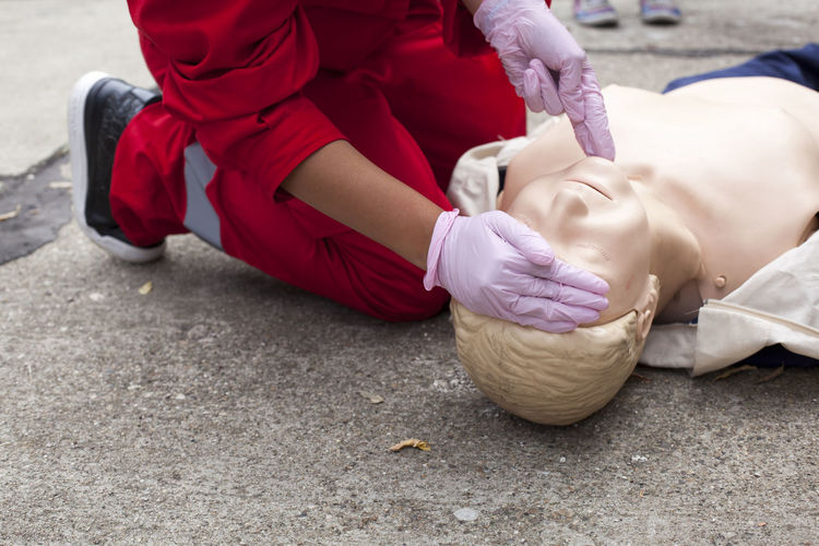 Paramedic performing cpr on mannequin