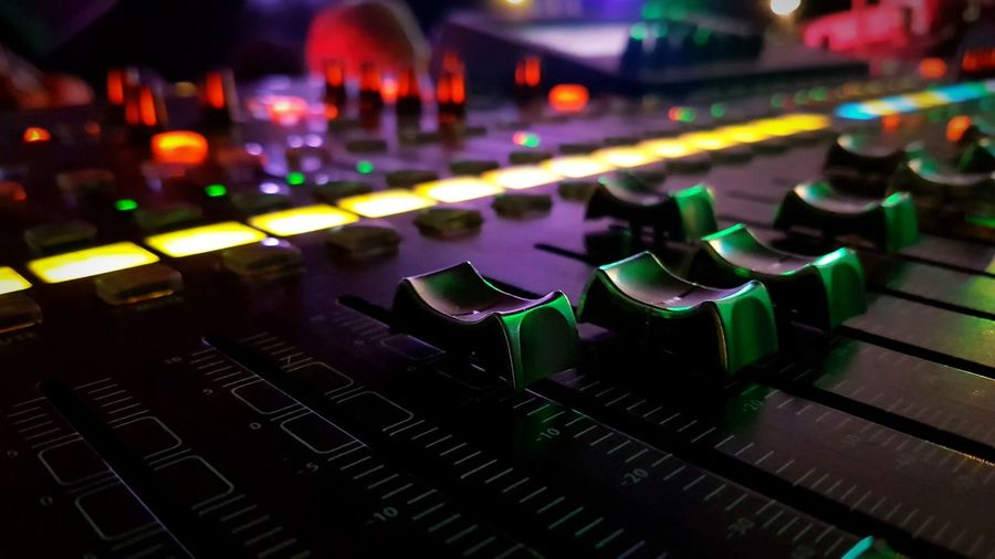 Close-Up Of Sound Mixer In Nightclub
