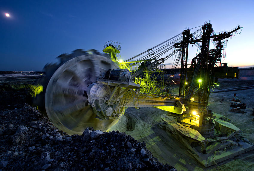 Russia, Stary Oskol, Stoilensky GOK, bucket wheel excavator, Stripping Blue Bucket Wheel Excavator Close-up Glowing Illuminated Nature No People Outdoors Sky Stripping The Land Sun