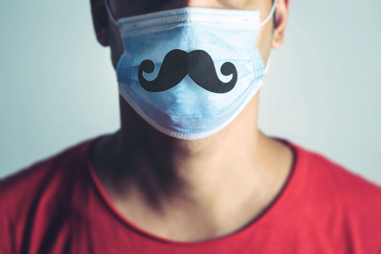 Portrait of person wearing mask against white background
