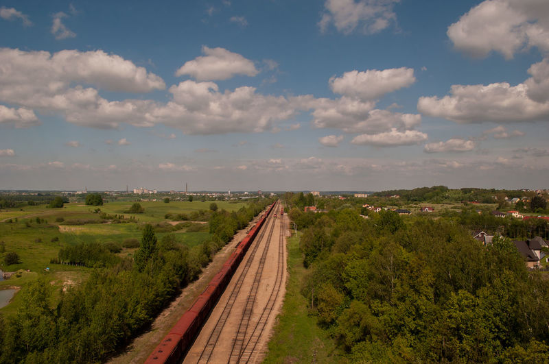 High angle view of freight train on railroad track amidst field