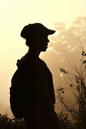 Side view of silhouette boy during sunset
