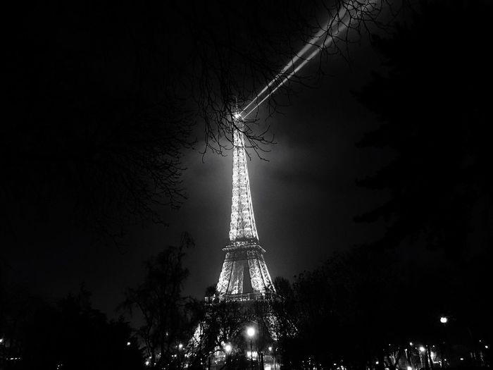Tree Built Structure Travel Destinations Night Architecture City Cultures Tower Sky Tourism Building Exterior Outdoors Illuminated Black And White Eiffel Tower Phare Light Monuments Paris No People Streetphotography Tower Buildings Fog Lights  Cloudy Sky Artistic Installations The City Light