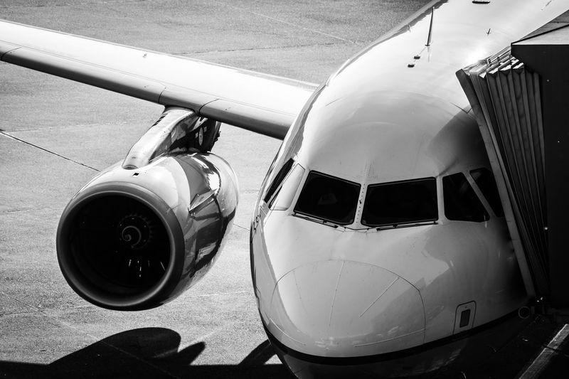 Traveling Travel Public Transportation Aeroplane Engine Gate Ramp Mode Of Transportation Airplane Air Vehicle Transportation Airport Day Travel No People Sunlight Outdoors Runway Close-up High Angle View Aircraft Wing Shadow Stationary Aerospace Industry Land Vehicle