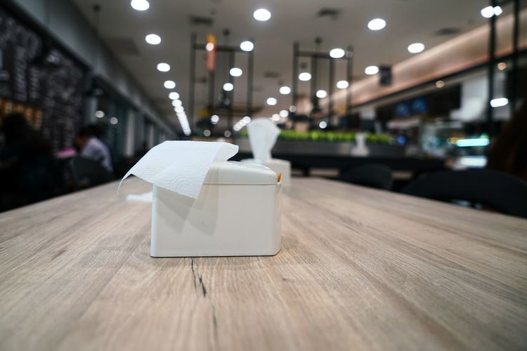 Close-up of tissue paper box on table at restaurant