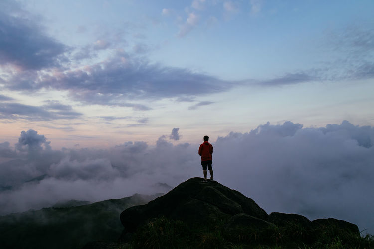 Silhouette man overlooking scenic cloudscape