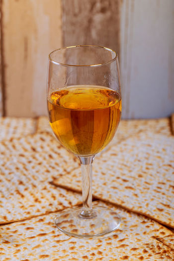 Close-Up Of Wineglass On Crackers